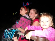 Lindsey, Destiny and Bailey bundled up and waiting for the fireworks to start!