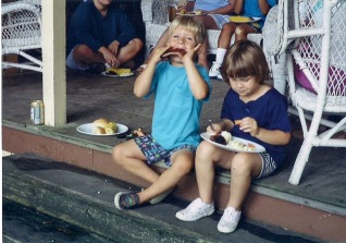 Here's a photo of my cousin and I getting down on some family treats. Just a couple years ago. Of course.