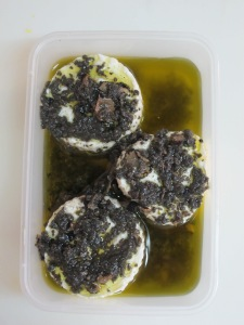 Toma marinated in black truffles and extra virgin olive oil.